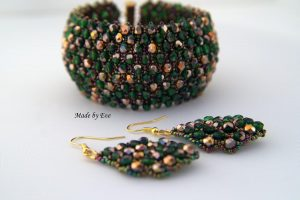 a jewelry set in gold and green