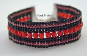 red and black bracelet on loom