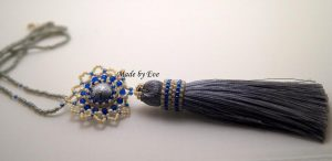 a jewelry set with a tassel