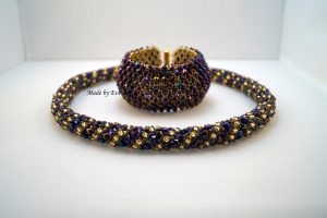 a gold and purple jewelry set