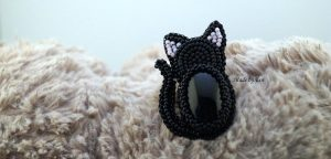 "a brooch with onyx ""black cat"""
