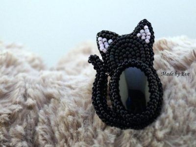 "Brooch with onyx ""black cat"""