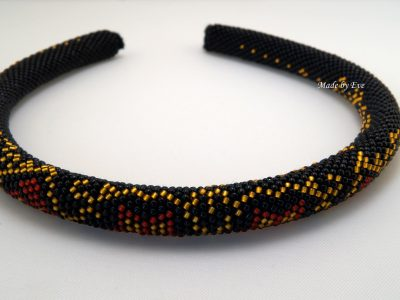 A red and black necklace in the harness beaded technique