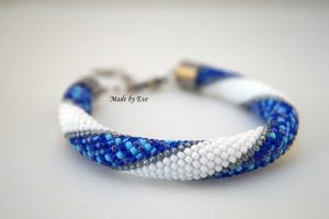 white and blue set of jewelry